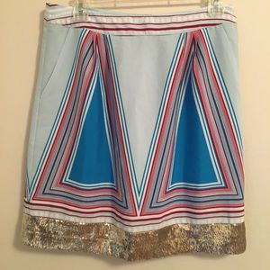 Isani colored triangle and gold glitter skirt